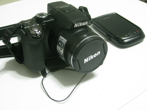 My Toys, a Nikon CoolPix P100 and a Blackberry Torch 9800