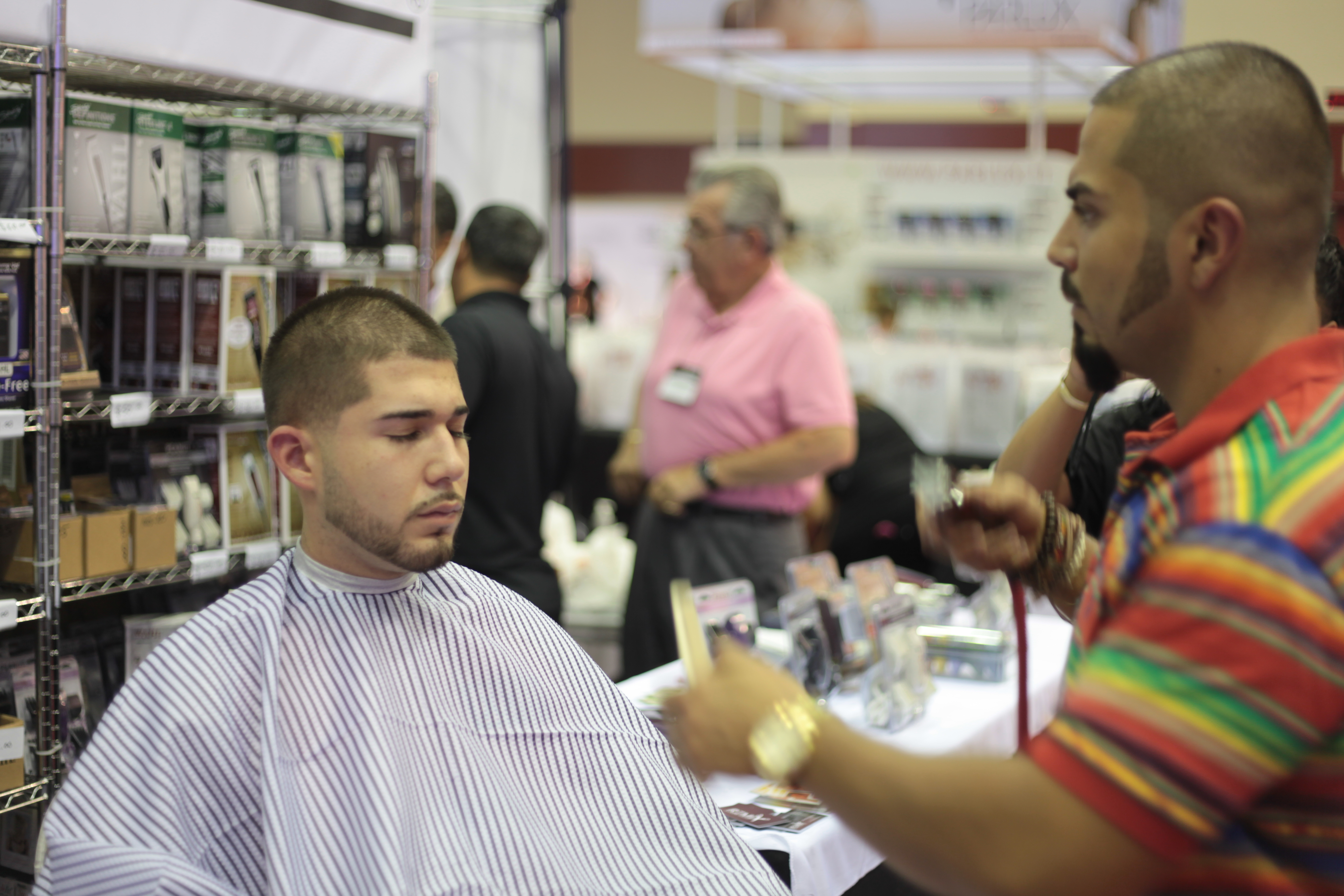 Brian Quintero of Pacino's Remix Barber Shop putting in some work .